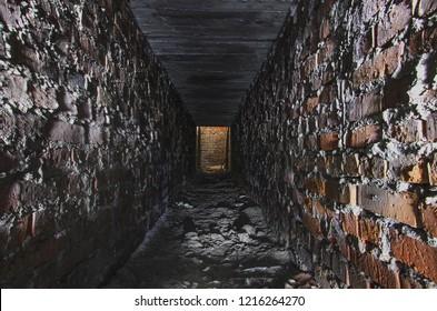 Long underground brick tunnel angle shot