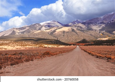 Long unpaved road to mountain