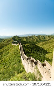 Long view of the Great Wall of China and green countryside
