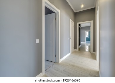 long white empty corridor in interior of entrance hall of modern apartments, office or clinic