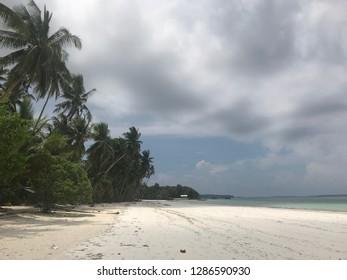 A long white sand beach in Kei Island, Indonesia, Ngurbloat Beach