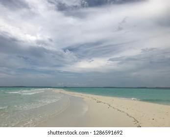 A long white sand beach in Kei Island, Indonesia, Ngurtafur Beach