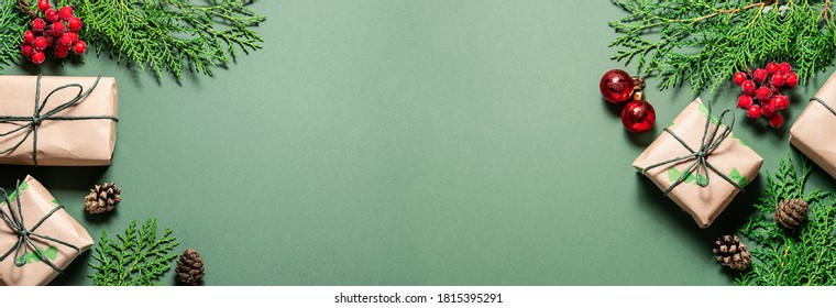 Long wide banner with bright Christmas decor on green background. Christmas and New Year greeting card template.