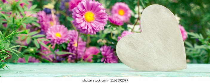 Long wide banner, cover. Wooden heart on a floral background.