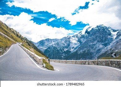 Long winding road at the last part of the Stelvio Pass seen from the top
