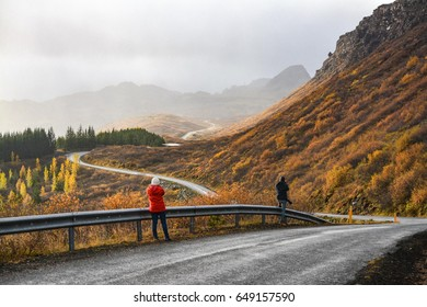 a long winding road leading through beautiful valley in Iceland.