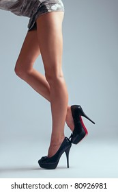 long woman legs in high heel shoes, studio shot, side view
