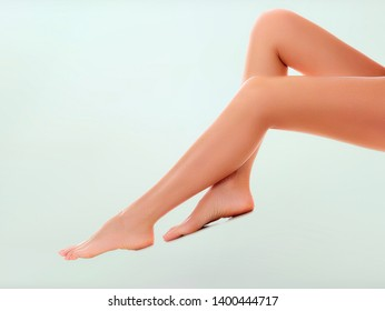 Long woman naked legs with smooth and clear skin