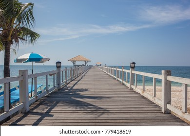 Long wood pier stretch to sea