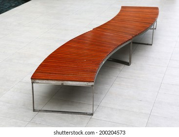 long wooden bench in the public park