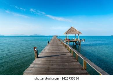 Long wooden bridge in beautiful tropical island beach - Koh Mak in Trat, Thailand.