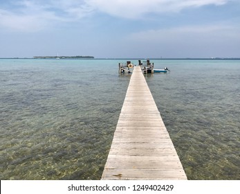 Long wooden bridge on the clear watercolor beach in Karimunjawa island, Central Java, Indonesia