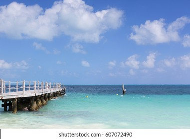 Long wooden dock on the shores of Caribbean sea.