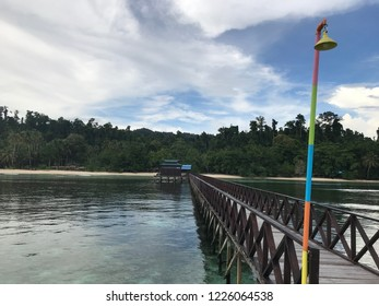 A long wooden pier into the homestay in Waisai beach Raja Ampat, West Papua Indonesia