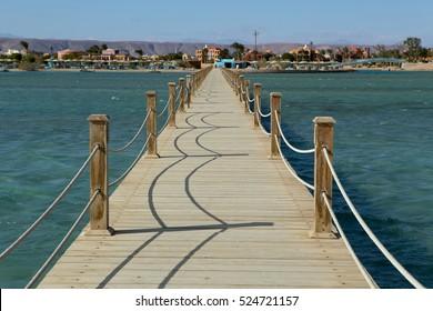 Long wooden pier into the sea. El Gouna. Egypt.