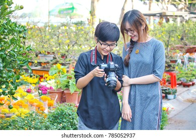Long Xuyen city, Vietnam - February 2, 2016: Young girls in annual Spring festival market at Long Xuyen city