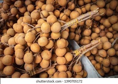 Longan fresh (Dimocarpus longan) A bunch of longan at market' fruit.