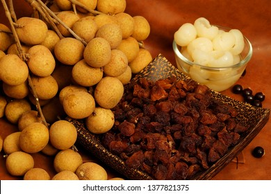 Longan product, dry longan, longan in syrup set with brown tone background