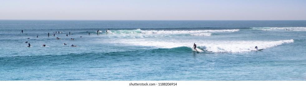 Longboard session at malibu beach, california