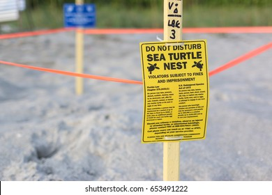 Longboat Key, FL - June 4, 2017: Signs warn people to stay away from a turtle nesting sight.