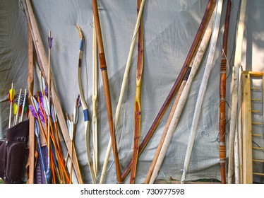 longbow-photo of a lot of bows standing on the wall