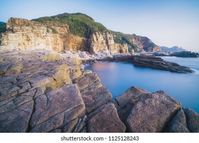 Longdong Bay Cape Coast Landscape - Northeast and Yilan Coast National Scenic Area. Long exposure at sunrise, shot in Gongliao District, New Taipei, Taiwan.