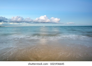 A longer exposer image of The sandy Torquay beach, Clouds on the Horizon. Hervey Bay, Queensland, Australia with