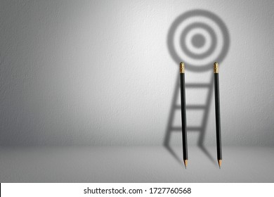 Longest shadow ladder stairs growing up growth to aiming high to goal target with pencil for effort and challenge in business to be achievement and successful concept