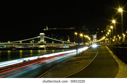 long-exposure shot of traffic on Budapest riverfront at night