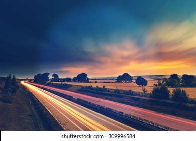 Long-exposure sunset over a highway with instagram vintage old effect