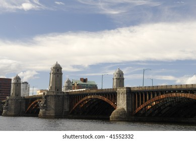 The Longfellow Bridge connects Beacon Hill, Boston to Kendall Square, Cambridge across Charles River.  The bridge is open since 1906 and currently carries traffic and the red subway line