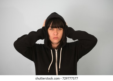 long-haired beautiful young brunette woman covering her ears with her hands, isolated on a white background
