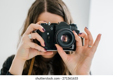 long-haired brunette girl photographed on an old camera