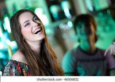 Long-haired girl in bar