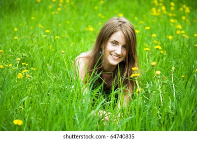 long-haired teen girl lying in meadow grass
