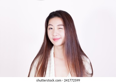 Long-haired, winking Chinese Girl Headshot