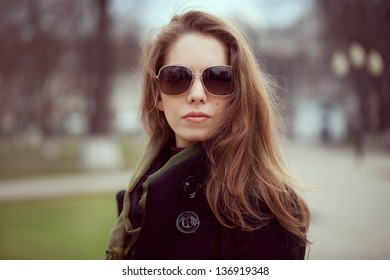 Long-haired young woman in a stylish fashion sunglasses