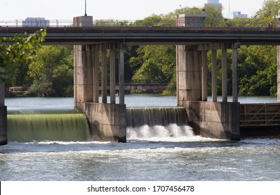 Longhorn Dam with two open gates at the east end of Lady Bird Lake in Austin Texas