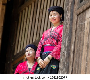LONGJI, CHINA - August 04, 2017: Traditional clothed women in Longji, China. Red Yao women living in Longji Yao village, China have one of the longest hair in the world.