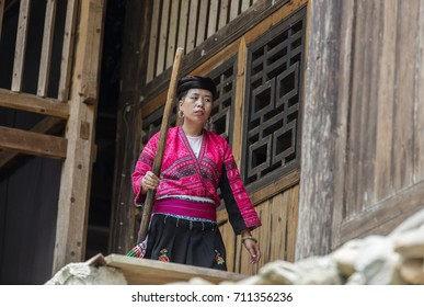 LONGJI, CHINA - August 04, 2017: Traditional clothed woman in Longji, China. Red Yao women living in Longji Yao village, China have one of the longest hair in the world.