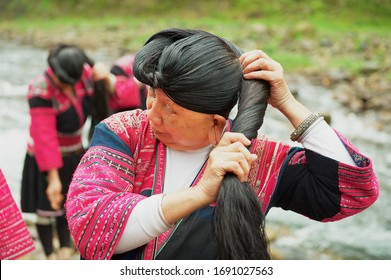 Longji, China - May 06, 2009: Women brush and style hair  in Longji, China. Women of Red Yao people living in Longji Yao village circa Guilin, China have one of the longest hair in the world.