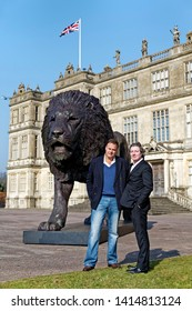 Longleat House, Wiltshire / UK - March 17 2016: A sculpture of a lion by African based sculptor Bruce Little (left) which was commissioned by Ceawlin Thynn, (right), Viscount Weymouth of Longleat