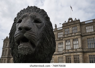 LONGLEAT, WILTSHIRE, UK - AUGUST 2017: Lion sculpture in front of the old English heritage stately home at Longleat in Wiltshire.