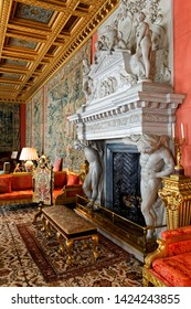 Longleat, Wiltshire/ UK - August 23 2012: A huge, Carrara marble fireplace, copied from the Doge's Palace in Venice is situated in this 17th Century, 90ft long room called the Saloon in Longleat House
