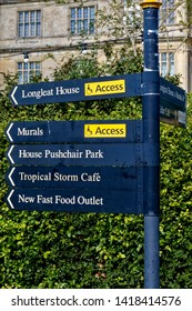 Longleat, Wiltshire / UK - July 17 2014: A Signpost pointing the way to attractions for visitors at Longleat House,Wiltshire, United Kingdom.