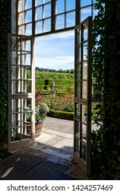 Longleat, Wiltshire / UK - July 17 2014: A view of the Love Labyrinth Garden through the doors of the Orangery at Longleat House, Wiltshire, United Kingdom.