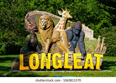 Longleat, Wiltshire, UK - May 24, 2016: The entrance sign to the safari park and house stands bathed in morning sunlight by the side of the main road