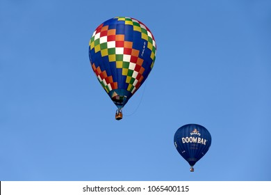 Longleat, Wiltshire, UK - November 18, 2015: Hot Air Balloons flying in a clear blue sky