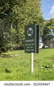 Longleat, Wiltshire, UK September 25th 2015 - Showing a danger information sign at the Longleat safari park