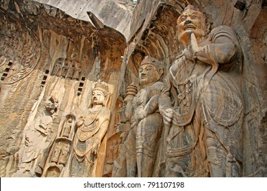 Longmen Grottoes : Massive Buddhist sculptures in the main grotto.The world heritage site, Chinese Buddhist art. Located in Louyang, Henan province China. Selective focus.